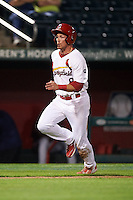 Springfield Cardinals outfielder Charlie Tilson (8) scores a run during a game against the Frisco RoughRiders  on June 3, 2015 at Hammons Field in Springfield, Missouri.  Springfield defeated Frisco 7-2.  (Mike Janes/Four Seam Images)