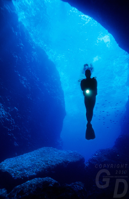 The perfect buoyancy a diver in the Saipan grotto, exploring the deep