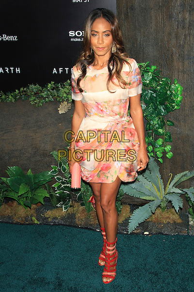 Jada Pinkett Smith<br /> The New York Premiere of &quot;After Earth&quot; at the Ziegfeld Theatre, New York, NY., USA.<br /> May 29th, 2013<br /> full length white pink floral print dress clutch bag red sandals strappy <br /> CAP/LNC/TOM<br /> &copy;LNC/Capital Pictures