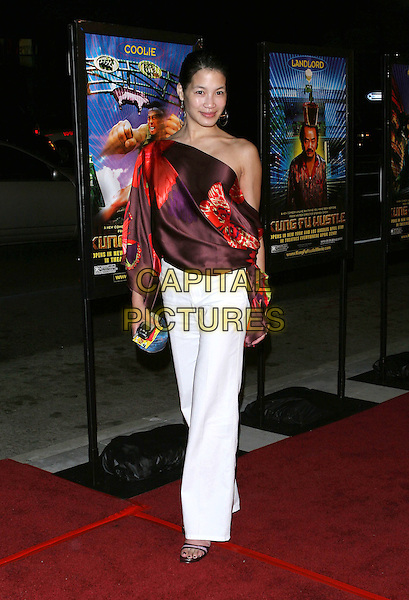 "EUGENIA YUAN.""Kung Fu Hustle"" Los Angeles Premiere held at the ArcLight Cineramadome, Hollywood, California..Photo Credit: Jacqui Wong/AdMedia.March 29th, 2005.full length white trousers silk satin off the shoulder brown and red top.www.capitalpictures.com.sales@capitalpictures.com.© Capital Pictures."