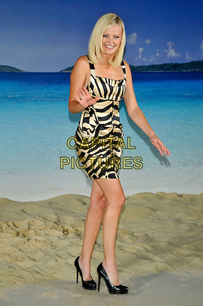 "MALIN AKERMAN .Photocall for the film ""Couples Retreat"", Claridges, London, England..October 15th, 2009.full length dress ackerman white cream black zebra print striped stripes animal hand waving.CAP/PL.©Phil Loftus/Capital Pictures."