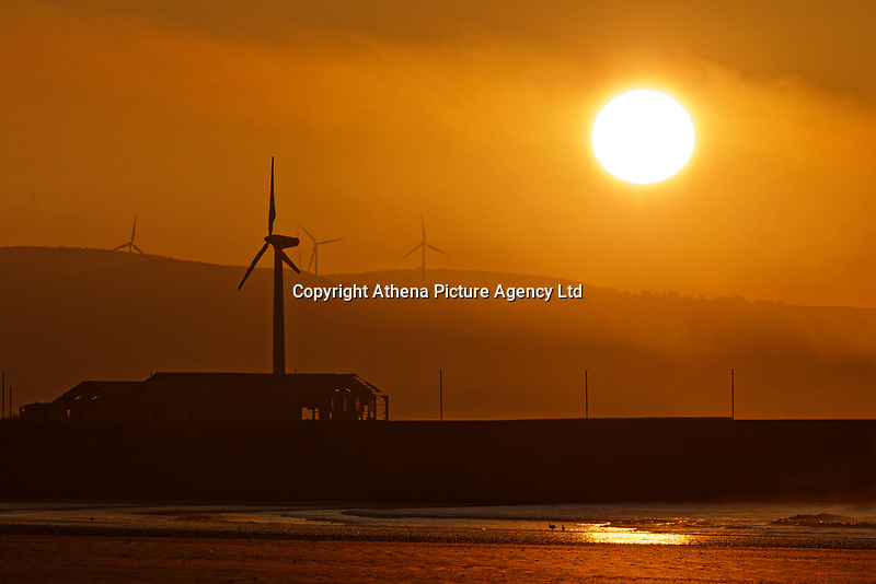 The sun rises over Swansea Bay in south Wales, UK. Tuesday 26 February 2019