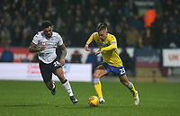 Leeds United's Kalvin Phillips chased by Bolton Wanderers' Josh Magennis<br /> <br /> Photographer Stephen White/CameraSport<br /> <br /> The EFL Sky Bet Championship - Bolton Wanderers v Leeds United - Saturday 15th December 2018 - University of Bolton Stadium - Bolton<br /> <br /> World Copyright &copy; 2018 CameraSport. All rights reserved. 43 Linden Ave. Countesthorpe. Leicester. England. LE8 5PG - Tel: +44 (0) 116 277 4147 - admin@camerasport.com - www.camerasport.com