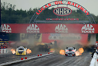 Aug. 31, 2012; Claremont, IN, USA: NHRA funny car driver Blake Alexander (right) races alongside Todd Lesenko during qualifying for the US Nationals at Lucas Oil Raceway. Mandatory Credit: Mark Rebilas-