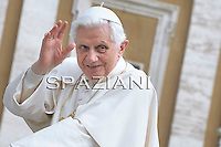 Pope Benedict XVI waves as he leaves his weekly general audience on  April 14, 2010 at St Peter's square at The Vatican.