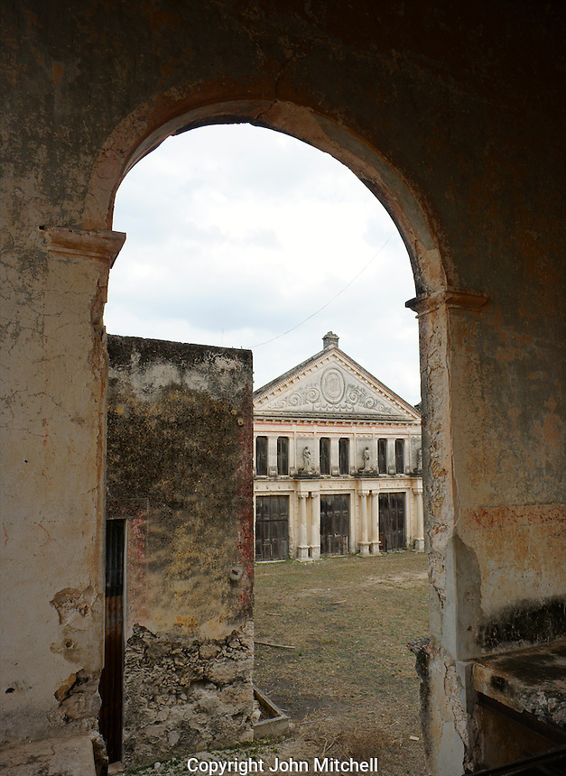The Neoclassic style henequen storehouse framed by arch, Hacienda Yaxcopoil, Yucatan, Mexico.