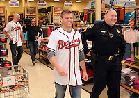 Shortstop Tyler Pastornicky of the Atlanta Braves walks out to greet fans on January 27, 2012 at Academy Sports and Outdoors in Spartanburg, South Carolina. It was the first day of the 2012 Braves Country Caravan, which visits cities all across the South prior to Spring Training. (Tom Priddy/Four Seam Images)