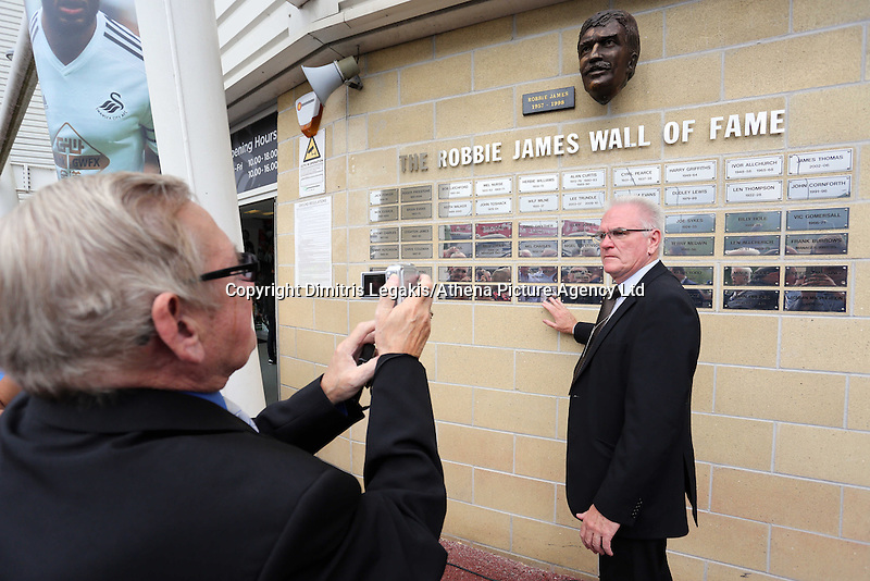 Pictured: Former footballer Tony Millington (R).  Saturday 22 September 2014<br /> Re: Unveiling of plaques at the Robbie James Wall of Fame at the Liberty Stadium, Swansea, south Wales.
