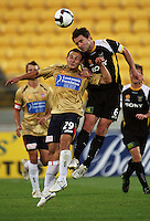 Tim Brown beats Sean Rooney to a header during the A-League match between Wellington Phoenix and Newcastle Jets at Westpac Stadium, Wellington, New Zealand on Sunday, 4 January 2009. Photo: Dave Lintott / lintottphoto.co.nz