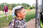 WOLCOTT, CT. 19 July 2019-071919 - Joseph Anton, 8, of the Waterbury Overlook Blacksox and from Woodbury tries to keep cool in the hot and muggy weather by putting an ice bag on his head, during the first annual Dave Pelletier Memorial Baseball Tournament for U8 at the Baseball Association of Wolcott fields in Wolcott on Friday. Dave Pelletier, a popular baseball coach who founded the unified sports program in Wolcott, died in November 2018 at the young age of 55.  Bill Shettle Republican-American