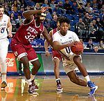 BROOKINGS, SD - JANUARY 13: Brandon Key #0 from South Dakota State University drives past Abiola Akintola #32 from Denver during their game Saturday afternoon at Frost Arena in Brookings, SD.  (Photo by Dave Eggen/Inertia)