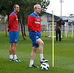 Steven Naismith having a fly scratch down his shorts as Steven Whittaker looks on