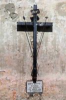 Crocifisso sul muro. Crucifix on the wall....