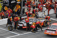 Feb 15, 2007; Daytona, FL, USA; Nascar Nextel Cup Series driver Martin Truex Jr (1) pits during race one of the Gatorade Duel at Daytona International Speedway. Mandatory Credit: Mark J. Rebilas