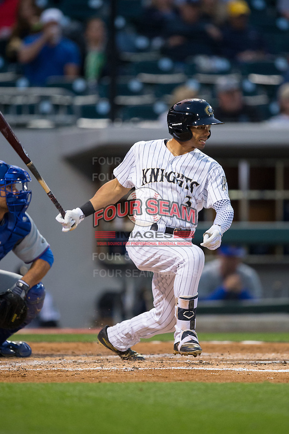 Jacob May (3) of the Charlotte Knights follows through on his swing against the Durham Bulls at BB&T BallPark on April 14, 2016 in Charlotte, North Carolina.  The Bulls defeated the Knights 2-0.  (Brian Westerholt/Four Seam Images)
