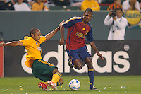 Los Angeles Galaxy's Kyle Veris knocks the ball away from Real Salt Lake's Atiba Harris in the first half at the Home Depot Center in Carson, CA on Saturday, May 13, 2006..RSL defeated L.A. 3-0.
