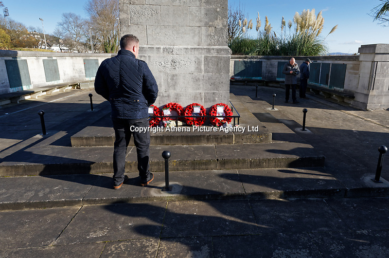 Pictured: A man at the Cenotaph in Swansea, Wales, UK. Sunday 10 November 2019<br /> Re: Remembrance SUnday, a service to commemorate those who lost their lives in conflict has been held at the Cenotaph in Swansea, Wales, UK.