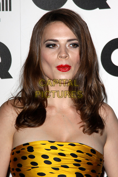 HAYLEY ATWELL.The GQ Men of The Year Awards held at The Royal Opera House, Covent Garden, London, England, UK..September 7th 2010.headshot portrait red lipstick strapless gold yellow black polka dot make-up funny.CAP/AH.©Adam Houghton/Capital Pictures.