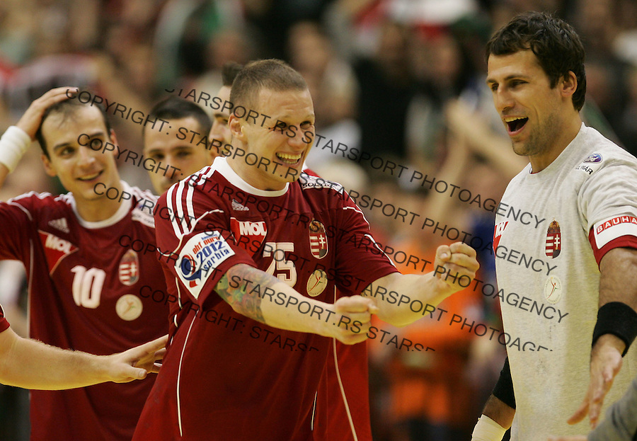 NOVI SAD, SERBIA - JANUARY 20: Szabolcs Zubai (C), celebrate victory against France teammates, during the Men's European Handball Championship 2012 group C match between France and Hungary at Spens Hall on January 20, 2011 in Novi Sad, Serbia. (Photo by Srdjan Stevanovic/Starsportphoto.com©)