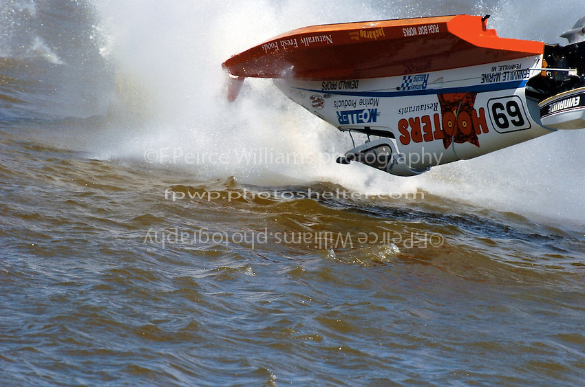 2004 Bay City River Roar, Bay City, Michigan, 26-27 June, 2004..Frame 13: .Jimmie Merleau blows his Hooters sponsored SST-45 tunnel boat over during the rough and windy final heat. Though the crash was spectacular, Merleau was uninjured and returned to competition to finish the race in the same boat...©F. Peirce Williams 2004..F. Peirce Williams .photography.P.O. Box 455 Eaton, Ohio 45320 USA.p: 317.358.7326 e: fpwp@mac.com