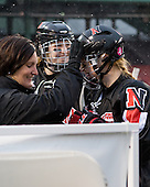 Linda Lundrigan (NU - Co-Head Coach), Kelly Wallace (NU - 5) - The University of New Hampshire Wildcats defeated the Northeastern University Huskies 5-3 (EN) on Friday, January 8, 2010, at Fenway Park in Boston, Massachusetts as part of the Sun Life Frozen Fenway doubleheader.