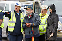 Pictured: Owner John Brandler (C) with contractors on site. Tuesday 28 May 2019<br /> Re: Contractors are working to move Banksy's Season Greeting, now owned by John Brandler, which appeared on a garage wall in Port Talbot, to a new location in the same town in south Wales, UK.