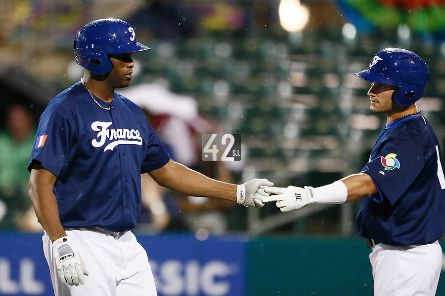 21 September 2012: Sneideer Santos is congratulated by Carlos Hereaud during France vs South Africa tie game 2-2, rain delayed at the end of the 9th inning at 1 AM, during the 2012 World Baseball Classic Qualifier round, in Jupiter, Florida, USA. Game to resume 22 September 2012 at noon.