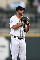 Starting pitcher Zac Grotz (15) of the Columbia Fireflies looks in for the sign during a game against the Charleston RiverDogs on Wednesday, August 29, 2018, at Spirit Communications Park in Columbia, South Carolina. Charleston won, 6-1. (Tom Priddy/Four Seam Images)