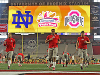 The Buckeyes warm up before the start of the Fiesta Bowl against Notre Dame at the  University of Phoenix Stadium in Glendale, AZ on January 1, 2016.  (Chris Russell/Dispatch Photo)