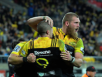 TJ Perenara and Brad Shields (right) congratulate Wes Goosen (obscured) on his try during the Super Rugby match between the Hurricanes and Crusaders at Westpac Stadium in Wellington, New Zealand on Saturday, 15 July 2017. Photo: Dave Lintott / lintottphoto.co.nz