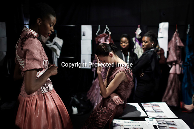 JOHANNESBURG, SOUTH AFRICA OCTOBER 24: Fashion model swait backstage before a show at Mercedes Benz Africa fashion week on October 24, 2012 held in Johannesburg, South Africa. African designers from around the continent showed their best fall/winter collections. (Photo by: Per-Anders Pettersson)