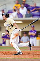 Mac Williamson #7 of the Wake Forest Demon Deacons follows through on his swing against the LSU Tigers at Alex Box Stadium on February 20, 2011 in Baton Rouge, Louisiana.  The Tigers defeated the Demon Deacons 9-1.  Photo by Brian Westerholt / Four Seam Images