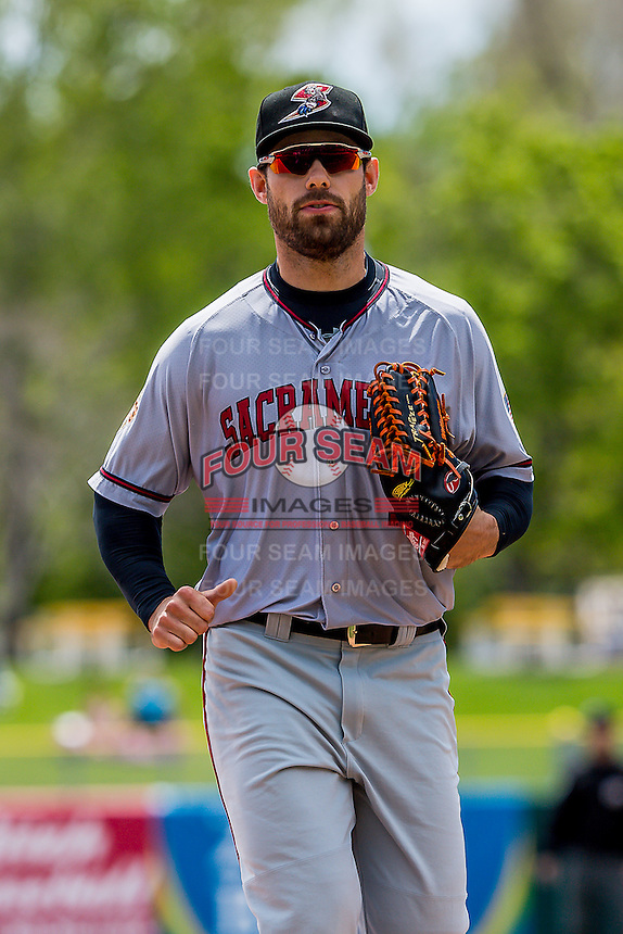 Mac Williamson (7) of the Sacramento River Cats during the game against the Salt Lake Bees in Pacific Coast League action at Smith's Ballpark on May 01, 2016 in Salt Lake City, Utah. Sacramento defeated Salt Lake 16-6.  (Stephen Smith/Four Seam Images)