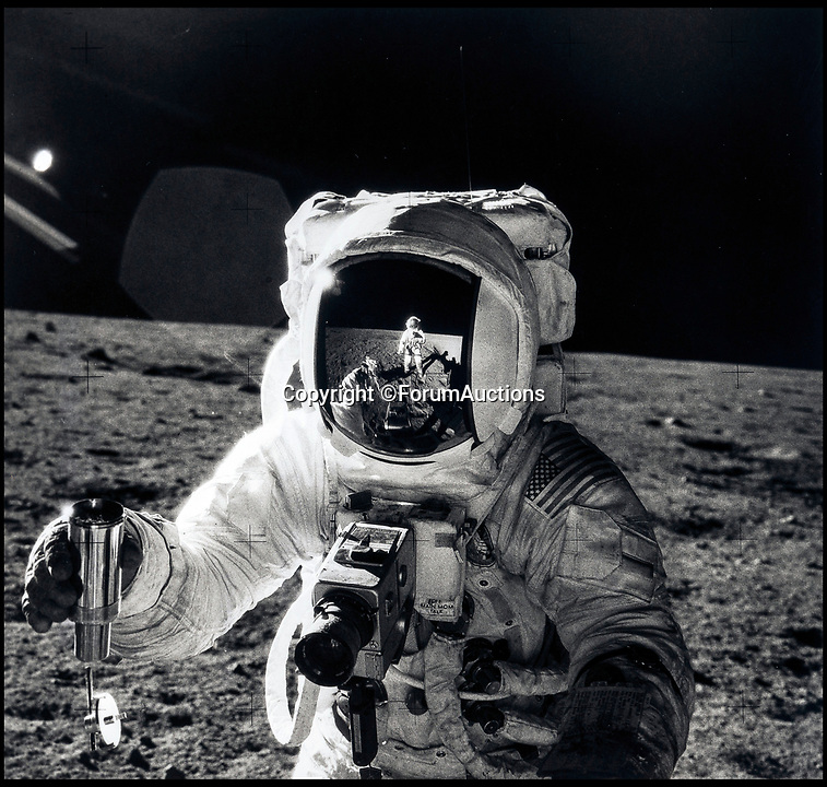 BNPS.co.uk (01202 558833)<br /> Pic: ForumAuctions/BNPS<br /> <br /> A surreal image of the lunar landscape reflected in Apollo 12 astronaut Alan Bean's gold plated visor.<br /> <br /> One small step for man...One giant leap for photography.<br /> <br /> An out of this world set of contemporary vintage photographs from NASA is coming up for auction chronicling the Apollo programs astonishing achievements over 45 years ago.