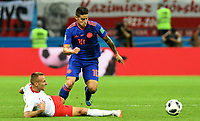 KAZAN - RUSIA, 24-06-2018: Jacek GORALSKI (Izq) jugador de Polonia disputa el balón con James RODRIGUEZ (Der) jugador de Colombia durante partido de la primera fase, Grupo H, por la Copa Mundial de la FIFA Rusia 2018 jugado en el estadio Kazan Arena en Kazán, Rusia. /  Jacek GORALSKI (L) player of Polonia fights the ball with James RODRIGUEZ (R) player of Colombia during match of the first phase, Group H, for the FIFA World Cup Russia 2018 played at Kazan Arena stadium in Kazan, Russia. Photo: VizzorImage / Julian Medina / Cont