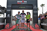 OCEANSIDE, CA - APRIL 7:  (L-R) 2nd place Lionel Sanders of Canada, 1st place Jan Frodeno of Germany, and 3rd place Tim Reed of Australia at the finish line during the IRONMAN 70.3 Oceanside Triathlon on April 7, 2018 in Oceanside, California. (Photo by Donald Miralle for IRONMAN)