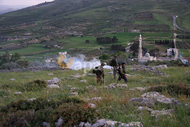 Israeli soldiers arrive at the scene during stone throwing clashes between Jewish settlers from the Har Bracha settlement and local Palestinian villagers close to Burin in the Israeli occupied West Bank on April 19, 2011. Three Palestinians were injured. Photo by Wagdi Eshtayah