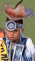 Boy age 5 wearing Native American ceremonial dress at Como Parks Traditional Pow Wow.  St Paul  Minnesota USA