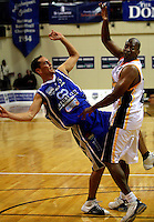 Troy McLean gets a pass away under pressure from Link Abrams during the NBL Basketball match between Wellington Saints and Devon Dynamos Taranaki at TSB Bank Arena, Wellington, New Zealand on Friday, 11 April 2008. Photo: Dave Lintott / lintottphoto.co.nz