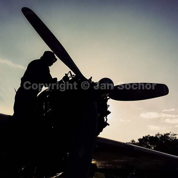 A Colombian mechanic repairs a propeller-driven engine of a Douglas DC-3 aircraft during the maintenance at the airport of Villavicencio, Colombia, 5 December 2016.