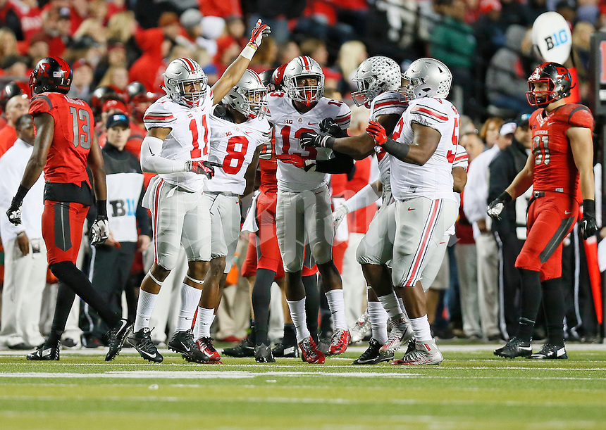 The Ohio State Buckeyes defense celebrates Ohio State Buckeyes cornerback Gareon Conley's (8) interception during the college football game between the Rutgers Scarlet Knights and the Ohio State Buckeyes at High Point Solutions Stadium in Piscataway, NJ, Saturday night, October 24, 2015. The Ohio State Buckeyes defeated the Rutgers Scarlet Knights 49 - 7. (The Columbus Dispatch / Eamon Queeney)