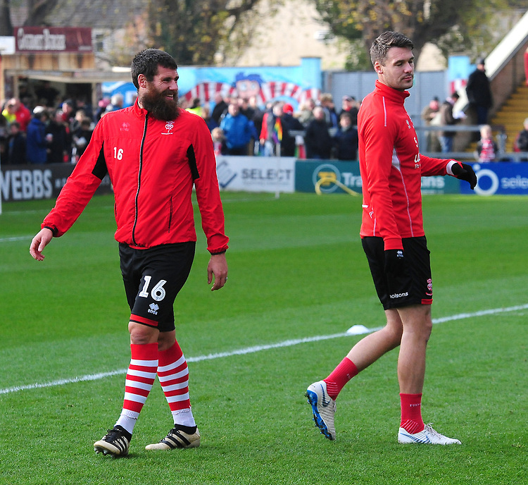 Lincoln City's Michael Bostwick, left, and Jason Shackell during the pre-match warm-up<br /> <br /> Photographer Andrew Vaughan/CameraSport<br /> <br /> The EFL Sky Bet League Two - Lincoln City v Mansfield Town - Saturday 24th November 2018 - Sincil Bank - Lincoln<br /> <br /> World Copyright © 2018 CameraSport. All rights reserved. 43 Linden Ave. Countesthorpe. Leicester. England. LE8 5PG - Tel: +44 (0) 116 277 4147 - admin@camerasport.com - www.camerasport.com