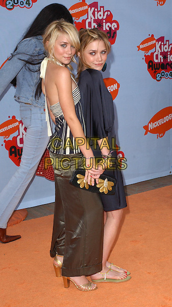 MARY KATE & ASHLEY OLSEN.Nickelodeon's 17th Annual Kids' Choice Awards held at UCLA's Pauley Pavilion in Los Angeles, California  .3 April 2004.*UK Sales Only*.full length, full-length, orange gold bag, flip flops, heels shoes sandals little black dress, identical twins, satin trousers.www.capitalpictures.com.sales@capitalpictures.com.©Capital Pictures.