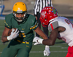 Bishop Manogue Miners  Peyton Dixon (10) runs by the attempted tackle by Arbor View Aggies Darius Harrison (23) in the second half of their NIAA 4A State Semi-Final football game played at McQueen High School on Saturday, Nov. 24,2018.