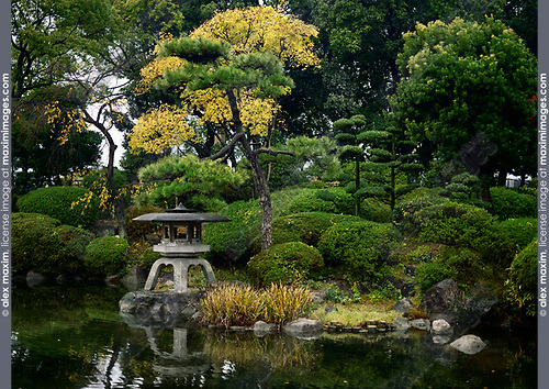 Little Japanese Zen garden with a lantern and a pond in Osaka Castle Park, beautiful tranquil autumn scenery. Osaka, Japan 2017 Image © MaximImages, License at https://www.maximimages.com