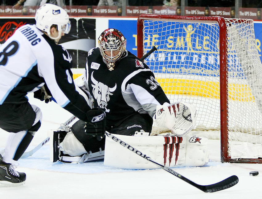 Milwaukee Admirals' Ryan Thang, left, shoots on San Antonio Rampage goaltender Matt Climie during the first period of an AHL hockey game, Wednesday, March 16, 2011, in San Antonio. (Darren Abate/pressphotointl.com)
