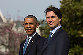 U.S. President Barack Obama (L) welcomes Prime Minister of Canada Justin Trudeau (R) at an arrival ceremony on the South Lawn of the White House, in Washington, DC, USA, 10 March 2016. This is the first official visit of Prime Minister of Canada Justin Trudeau to the White House. <br /> Credit: Jim LoScalzo / Pool via CNP