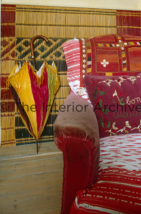 In the living room Moroccan palm-fibre matting has been used to cover the walls and coordinates with the North African fabrics on the sofas and armchairs
