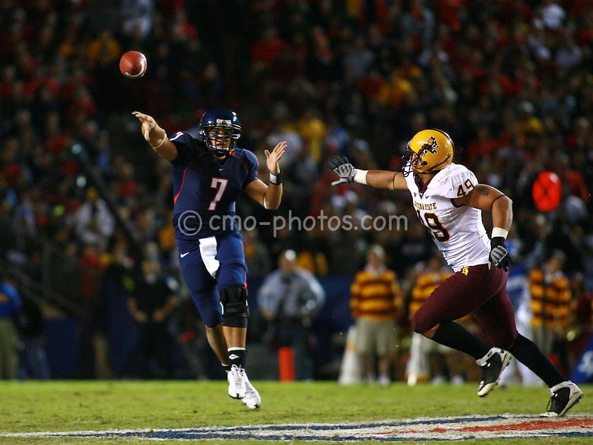 Dec 6, 2008; Tucson, AZ, USA; Arizona Wildcats quarterback Willie Tuitama (7) throws a pass while Arizona State Sun Devils linebacker Brandon Magee (48) applies pressure in the first quarter of a game at Arizona Stadium.