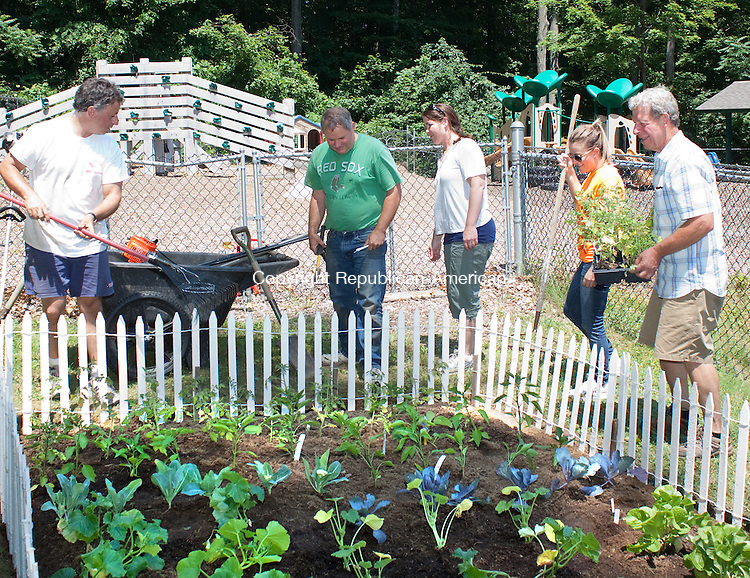 WINSTED, CT- JUNE 21 2011-062112DA03- Volunteers from Alcoa Howmet, from left, Paul Masucci, Mike Sulivan, Teri Lemelin, Kate Ballesteros and Fran Molitor build a vegetable garden at Winsted Area Child Care in Winsted during Northwestern Connecticut's United Way Day of Caring